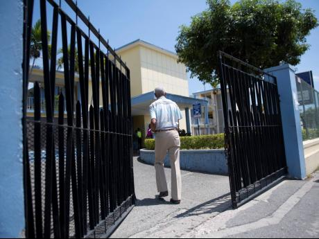A man entering the gates of the Ministry of Finance, National Heroes Circle, Kingston on March 30, 2020. The Ministry of Finance will host an online paltform, InvestmentMap, that will add transparency to government's spending habits.