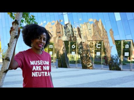 La Tanya Autry, a curatorial fellow at the Museum of Contemporary Art, Cleveland, poses outside the museum on Thursday, October 8.