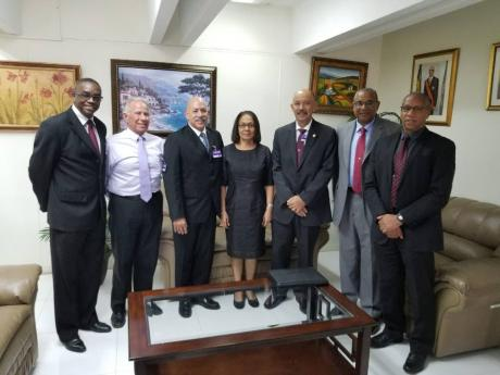 In this June 2016 photo, the executive of the Jamaica Society for Industrial Security (JSIS) executive posing with Minister of Labour and Social Security Shahine Robinson after paying her a courtesy call, discussing matters such as the ministry's monito