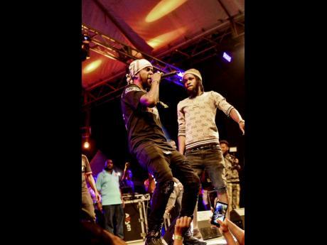 Popcaan performs with his protégé Quada at Ghetto Splash last year December.