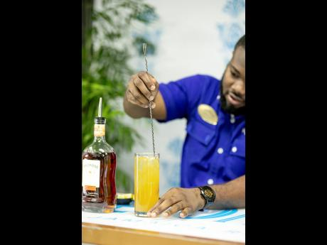 JWN Academy trained mixologist Randeen Thomas gently stirs a Stormy Valley cocktail to perfection at Appleton Estate's Home is Where is the Rum is mixology session.