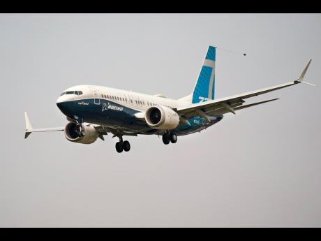 AP A Boeing 737 Max jet, piloted by Federal Aviation Administration chief Steve Dickson, prepares to land at Boeing Field following a test flight in Seattle on September 30.