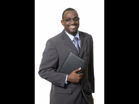 Oliver Tomlinson, president of the Insurance Association of Jamaica.