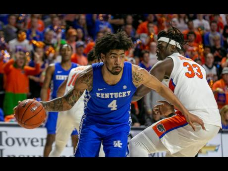 Forward Nick Richards drives to the basket during the second half of an NCAA college game between Kentucky and Florida in Gainesville, Florida, on Saturday, March 7.