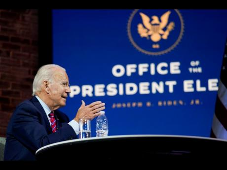 President-elect Joe Biden speaks during a meeting at The Queen theatre in Wilmington, Delaware, on Monday.