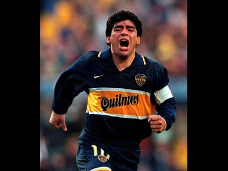 FILE  In this Oct 25, 1997 file photo, Diego Armando Maradona celebrates a goal on his last official soccer game with Boca Juniors in Buenos Aires, Argentina. The Argentine soccer great, who was among the best players ever, and who led his country to the 1