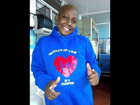 Raje Josephs wears one of the custom shirts his mom sells to raise funds for his cancer treatment.