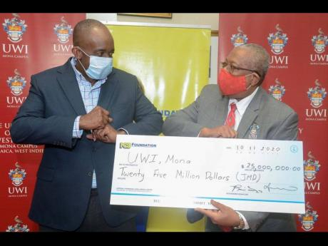 President and chief executive officer, National Commercial Bank Financial Group, Patrick Hylton, hands over a cheque valued at $25 million to Principal of UWI, Mona, Dale Webber, highlighting the continued support for education via the Gratitude Fund. In 2