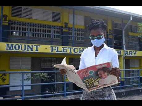 Fifth-grade teacher at Mount Fletcher Primary School, Nyla Louza, is overjoyed after receiving learning kits from the Ministry of Education, Youth, and Information on Wednesday.