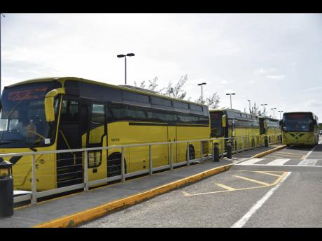 A line of JUTC buses. 			        File photos