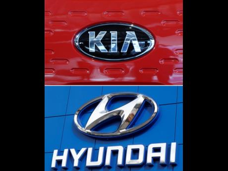This combination of file photos shows the logo of Kia Motors and Hyndai during an unveiling ceremony, December 13, 2017, in Seoul, South Korea.