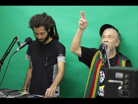 Skunga Kong (left) and his Father I Kong.