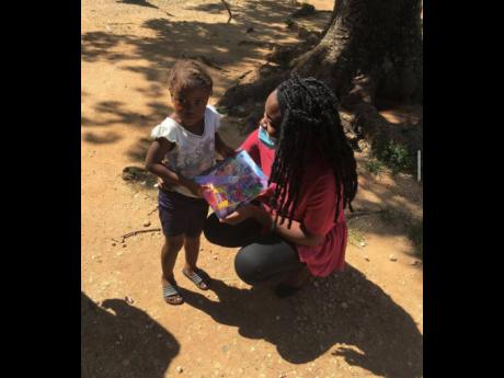 Janice Howell gives a book to a young girl