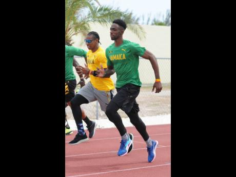 Kemar Bailey-Cole (right) and Yohan Blake jog during a training session at the Thomas Robinson National Stadium in Nassau, Bahamas, on Friday April 21, 2017 during the World Relays.