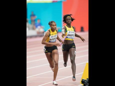 Tiffany James hands the baton to Stephenie-Ann McPherson during the women's 4x400m relay at the 2019 IAAF World Athletic Championships held at the Khalifa International Stadium in Doha, Qatar, on Sunday, October 6, 2019. The team that finished third in t
