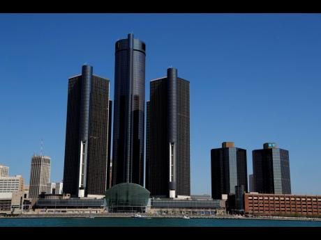 This May 12, 2020, photo shows a general view of the Renaissance Center, headquarters for General Motors, in Detroit.