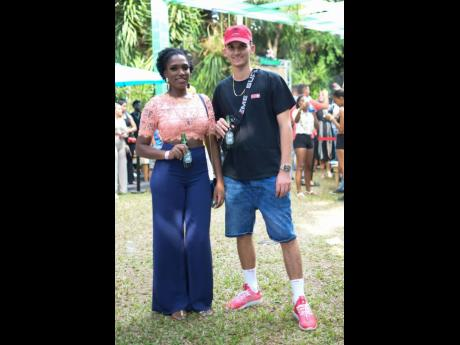 Jodi Hylton, brand manager, beers, the HEINEKEN Company and Director for Zimi Entertainment Nicholas 'Zimi Nick' Mahfood beat the heat with ice cold beers at a 2019 staging of Zimi Seh Brunch.