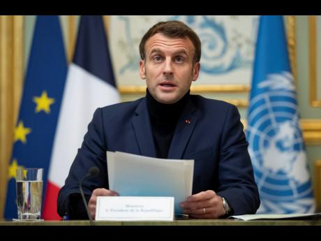 French President Emmanuel Macron makes introductory remarks during a visioconference meeting about support and aid for Lebanon, at the Elysee Palace in Paris, yesterday.