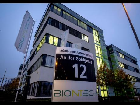 AP In this Tuesday, November 10, 2020 file photo, windows are illuminated at the headquarters of the German biotechnology company BioNTech in Mainz, Germany.