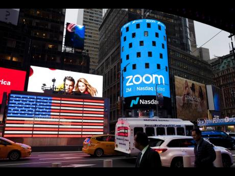 AP This April 18, 2019 file photo shows a Zoom ad in New York. Zoom's videoconferencing service remains a fixture in this pandemic-affected  life, but its breakneck growth is showing signs of tapering off.