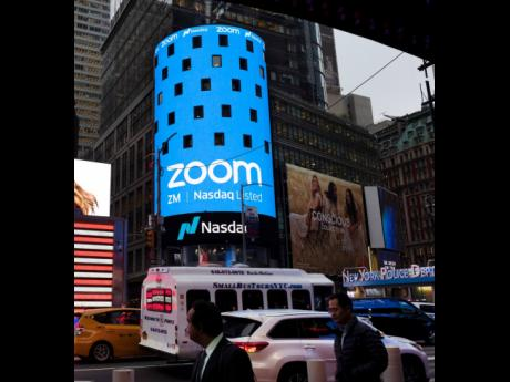 This April 18, 2019 file photo shows a Zoom ad in New York. Zoom's videoconferencing service remains a fixture in this pandemic-affected  life, but its breakneck growth is showing signs of tapering off.