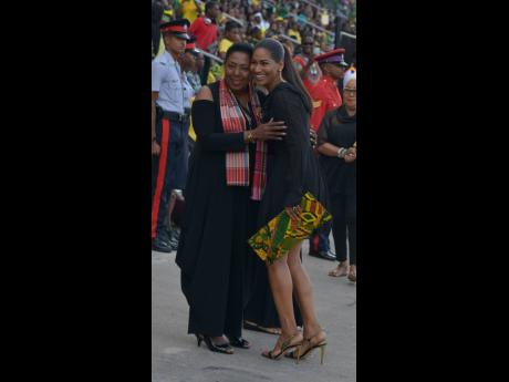 Culture Minister Olivia Grange (left) greets then opposition foreign affairs and foreign trade spokesperson, Lisa Hanna, at the 2018 Grand Gala at the National Stadium. The audit report said that there was no record the JCDC recovered the overpaid amount