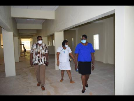 From left: Montego Bay Mayor Leeroy Williams, Matron Jacqueline Wilson and Inspector of Poor Pauline Lecky walk the halls of the soon to be completed ward at the St James Infirmary during a recent tour.