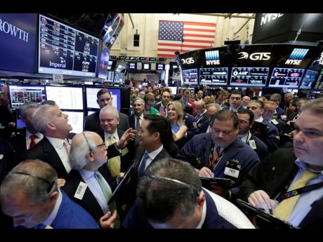 AP  New York Stock Exchange, NYSE,  floor governor Rudy Maas (left) calls out prices during the IPO of MGM Growth Properties on the floor of the NYSE on Wednesday, April 20, 2016. Wall Street has rolled out the welcome mat for companies going public this y