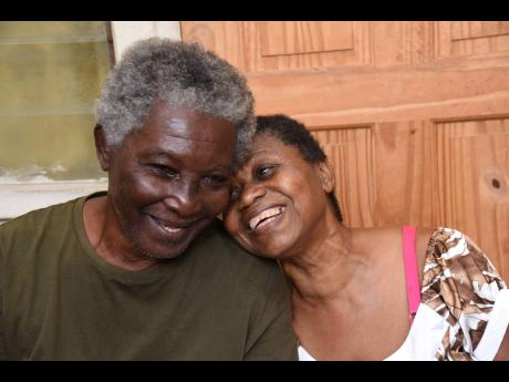 Visually impaired couple Clinton and Lorna Stewart enjoying each other's company at their rented home in Cockburn Gardens in St Andrew. They are appealing for help to complete their house in Portmore, St Catherine.