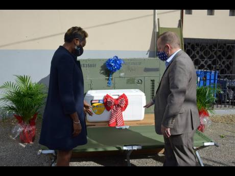 Minister of state in the Ministry of Health and Wellness Juliet Cuthbert Flynn accepted a donation of medical equipment and supplies valued at more than US$300,000 from the United States Embassy's Chargé d'Affaires John McIntyre at Glen Vincent Health