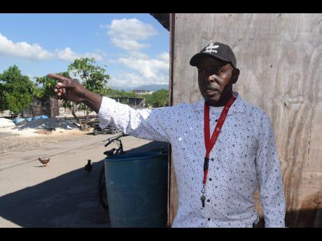 Right: Winston Monroe, chairman of the Greenwich Town Fisherfolk Benevolent Society in Kingston, says there won't be many smiles around the village for Christmas.
