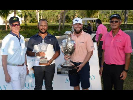 From left: Scott Summy, representing sponsors Aqua Bay Villas, poses with amateur winner William Knibbs, pro winner Erik Barnes and President of the Jamaica Golf Association, Peter Chin, during the presentation ceremony of the Jamaica Open tournament, whic