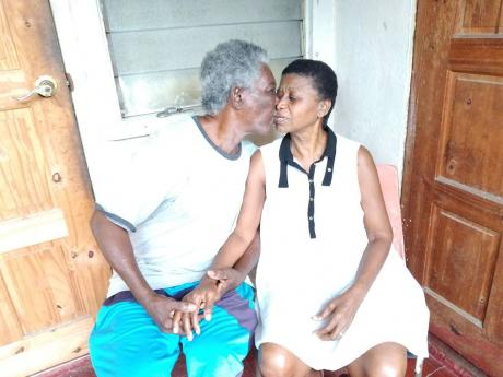 Elderly blind couple Clinton and Lorna Stewart share a kiss at their current rented premises in Cockburn Gardens, St Andrew.
