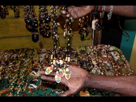Zodiac sign bead chains made by Glenford Bennett in Trench Town, Kingston.
