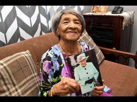 Elsie Smikle shows off a congratulatory card she received from the Queen last year as she celebrated her 100th birthday.