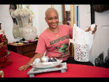 Swaydean Simpson shows off one of her craft creations at her home in Fletchers Land, Kingston, from which she operates a business after an accident triggered her interest in craft.