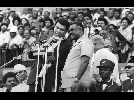 World heavyweight boxing champion Muhammad Ali (left) saying thanks as he holds the Key to the City of Kingston. The Key symbolizes freedom of the city and was presented to him on December 29 by the Mayor of Kingston, Councillor Ralph Brown, at the grand r