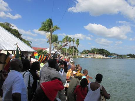 People offer flowers at Black River, St Elizabeth, in this 2015 file photo. They were participating in a ceremony to remembrance of the Zong Massacre between November 29 and December 1, 1781.