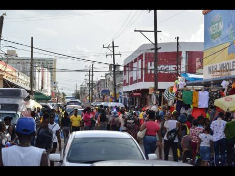 In this file photo, holiday shoppers jostle with motorists on Orange Street in downtown Kingston before COVID.