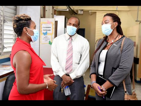 Minister of State in the Ministry of Health and Wellness, Juliet Cuthbert-Flynn (left), speaking with Burknell Stewart (centre), CEO of KPH and VJH, and Diane McIsaacs, deputy CEO, KPH and VJH, at the opening ceremony for the new breastfeeding room that wa