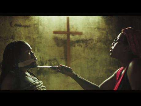 Kadeem Wilson (left), who plays the role of Algie, is interrogated by Sherando Ferril, Elsie, in a scene from the short film 'Sweet Rind'.