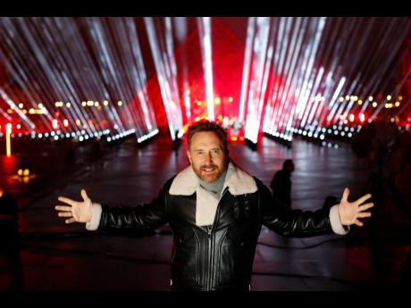 French DJ David Guetta poses for photographers in the courtyard of the Louvre museum in Paris on Tuesday.