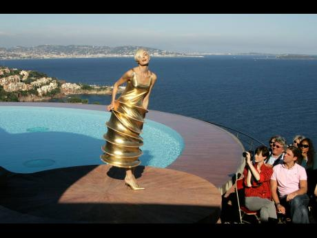 A model wears a creation by French fashion designer Pierre Cardin during the presentation of his entire Spring-Summer 2009 and Autumn-Winter 2009 collections at his villa in Theoule sur Mer, southern France.