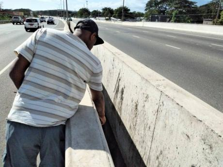 Richard Goodall points to the opening he fell through along a section of the Mandela Highway in St Catherine, on the night of December 15, 2020. He sustained minor injuries in the incident.