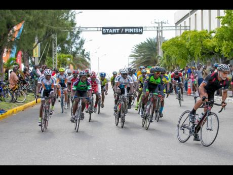 Cyclists take part in a Jamaica Cycling Federation (JCF) Kingston Criterium on Ocean Boulevard in downtown Kingston. The JCF is embarking on a youth programme to have a larger matriculation number of senior cyclists for major international competitions.