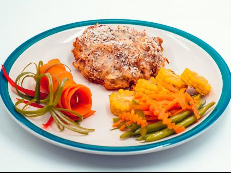 Nella's sweet potato pasta bake surprise is served with fresh steamed and raw vegetables.
