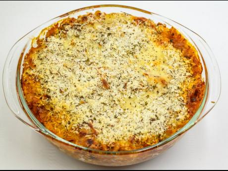 The casserole should be baked for 20 to 25 minutes until it is hot, and the cheese is lightly browned on top.