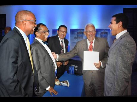 Sharing happiness: Harry's laughter was contagious, as seen in this photo of him (second left) sharing a joke at a recent Caribbean Shipping Association (CSA) meeting with (from left) Trevor Riley, CEO of The Shipping Association of Jamaica (SAJ); Grantl