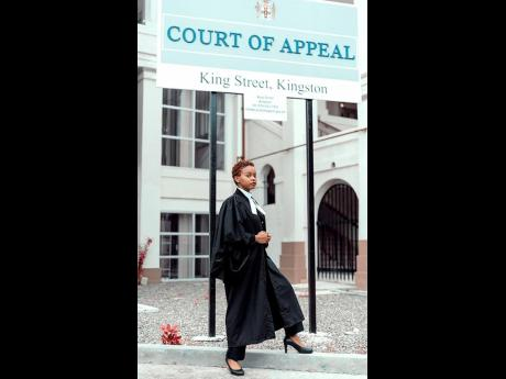 Montegonian Caleigh Reid poses outside of the Court of Appeal in Kingston shortly after passing the Bar recently.