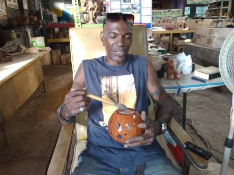 Garfield Williams says the switched from importing white clay to using local clay to create his pieces has been paying off.